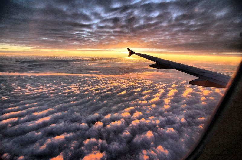 sunset-above-the-clouds-from-an-airplane